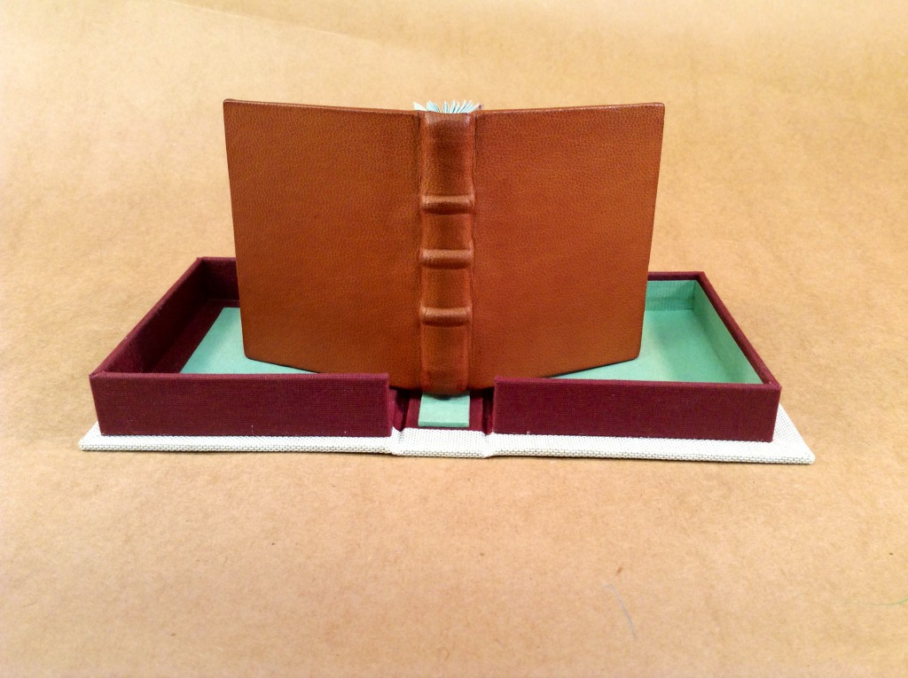 Leather binding and cloth clamshell