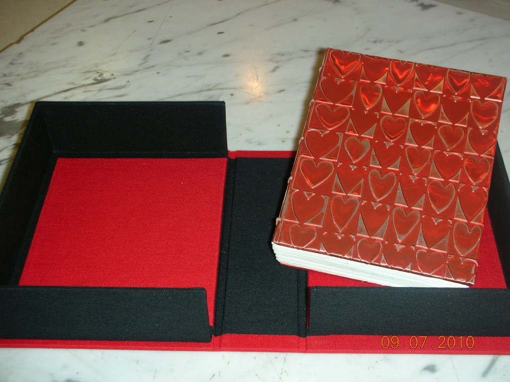 Book with aluminum embossing in clamshell